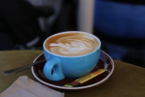 Coffee with sugar sachet on saucer
